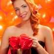 Woman with gift — Stock Photo #34693455
