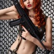 Girl with gun — Stock Photo #34693587