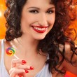 Stock Photo: Womwith candy