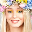Young woman with flower wreath — Stock Photo #34693967