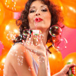 Woman blowing soap bubbles  — Stock Photo