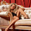 Blond on a sofa — Stock Photo #34694609