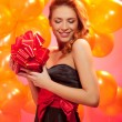 Woman with gift — Stockfoto