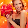 Woman with gift — Lizenzfreies Foto