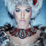 Girl in furs — Stock Photo #34695477