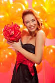 Woman with gift — Stock Photo