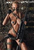 Girl with gun — Stok fotoğraf