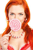 Woman with lollipop — Stock fotografie