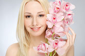 Girl with orchids — Stock Photo