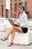 Woman with laptop computer — Stock Photo
