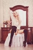 Girl in luxury interior — Stock Photo