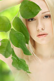 Girl with green sprout — Stock Photo