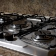 Burners on the gas stove in the kitchen — Stock Photo #34652407