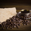 Grains and cup of coffee — Stock Photo