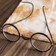 Old glasses on vintage document — Stockfoto #34654043