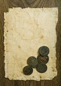 Vintage paper with coins — Photo