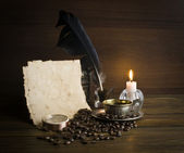 Grains and cup of coffee with a candle — Stock Photo