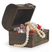 Open treasure chest with jewelry isolated on white — Stock Photo