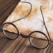 Old glasses on the vintage document — Foto Stock