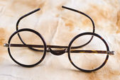 Antique XIX century glasses in selective focus — Photo