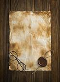 Oude bril op het vintage document — Stockfoto