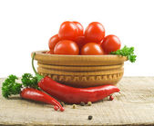 Tomato and red hot chili peppers — Stock Photo