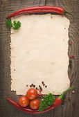 Old paper sheet and vegetables for a menu or recipe — Stockfoto