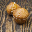 Cupcake on wooden background — Stock Photo