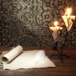 Old paper with a candle and a quill pen — Stock fotografie