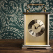 Clock on wooden background — Stock Photo #34864247