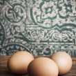 Chicken eggs on kitchen table — Stock Photo