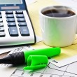 Coffee and calculator on paper table with diagram — Stok fotoğraf