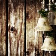 Stock Photo: Bells on wooden wall