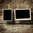 Aged photo frames on wood background — Stock Photo