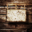 Old paper on brown wood texture with natural patterns — Stock Photo