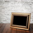 Old photo frame on the wooden table — Stock Photo #34866395