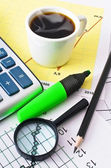 Coffee and calculator on paper table with diagram — 图库照片