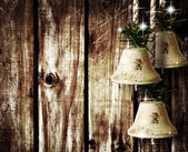 Bells on wooden wall — Stock Photo