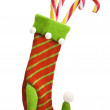 Christmas sock with gifts on white background — Stock Photo