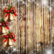 Bells and stars on wooden wall — Stock Photo