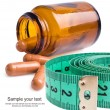 Stock Photo: Measure tape with pills