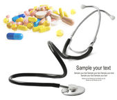 Stethoscope and pills isolated — Stock Photo