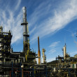 Oil refinery plant against blue sky — Stock Photo #35392961