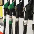 Pump nozzles at the gas station (selective focus) — Stock Photo