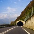 Tunnel with road and traffic signs — Stock Photo