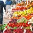 Fruit market with various colorful fresh fruits and vegetables — Stock Photo #35404643