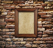 Wooden frame on brick wall — Stock Photo