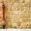 Red fire hydrant in the wall. — Stock Photo