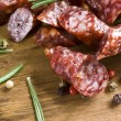 Smoked sausage with rosemary — Stock Photo
