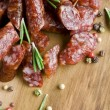 Smoked sausage with rosemary — Stock Photo #35974873